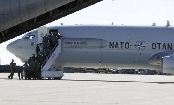 Airmen board a NATO AWACS aircraf during a joint NATO military exercise in Siauliai